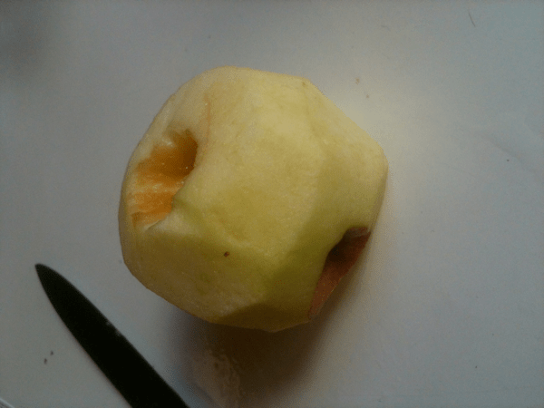 An apple with a crooked core.